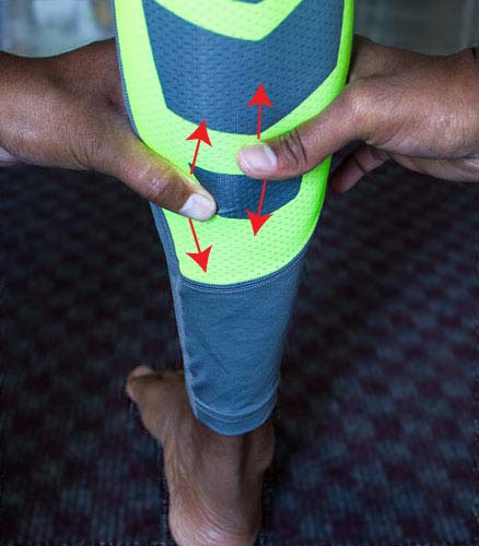 Muscle recovery massage of calf using hands