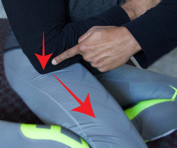 Muscle recovery massage of IT band using hands